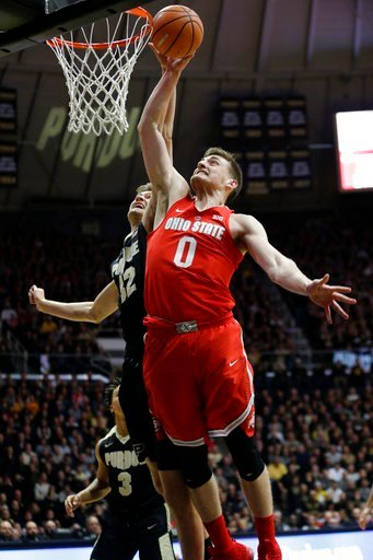(AP Photo/AJ Mast). Ohio State center Micah Potter (0) goes to the basket in front of Purdue forward Matt Haarms (32) during the first half of an NCAA college basketball game in West Lafayette, Ind., Wednesday, Feb. 7, 2018.