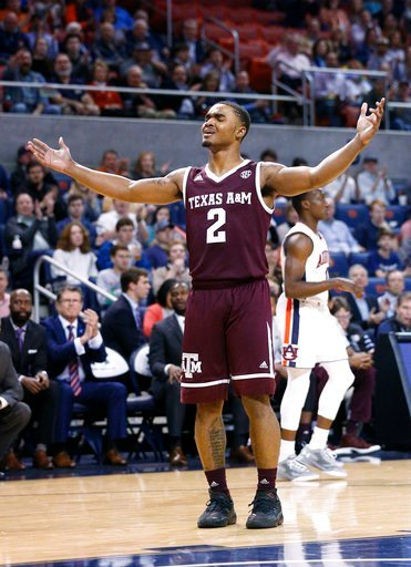 (AP Photo/Brynn Anderson). Texas A&M guard TJ Starks reacts after fouling Auburn forward Horace Spencer during the first half of an NCAA college basketball game on Wednesday, Feb. 7, 2018, in Auburn, Ala.