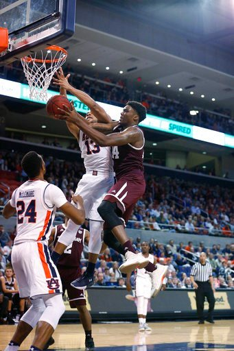 (AP Photo/Brynn Anderson). Texas A&M forward Robert Williams rebounds the ball against Auburn forward Desean Murray during the first half of an NCAA college basketball game on Wednesday, Feb. 7, 2018, in Auburn, Ala.