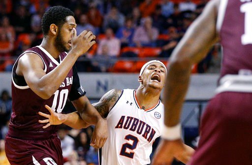 (AP Photo/Brynn Anderson). Auburn guard Bryce Brown reacts to being fouled by Texas A&M center Tonny Trocha-Morelos during the first half of an NCAA college basketball game on Wednesday, Feb. 7, 2018, in Auburn, Ala.