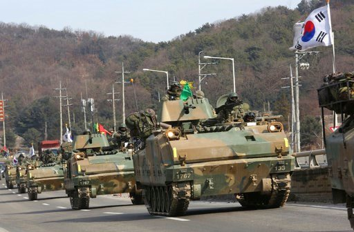 "(AP Photo/Ahn Young-joon). South Korean army's armored vehicles move during a military exercise in Paju, South Korea, near the border with North Korea, Wednesday, Feb. 7, 2018. Vice President Mike Pence said the U.S. is preparing to announce the ""tough..."