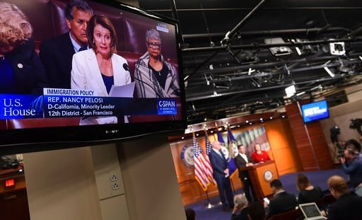 (AP Photo/Susan Walsh). House Minority Leader Nancy Pelosi of Calif., is shown on television as she speaks from the House floor on Capitol Hill in Washington, Wednesday, Feb. 7, 2018.