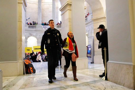 (AP Photo/Jacquelyn Martin). A woman is arrested by Capitol Police after participating in an act of civil disobedience in support of the Deferred Action for Childhood Arrivals (DACA) program, in the Russell Rotunda, Wednesday, Feb. 7, 2018, on Capitol ...