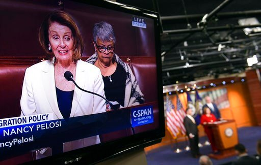 (AP Photo/Susan Walsh). House Minority Leader Nancy Pelosi of Calif., is shown on television as she speaks from the House floor on Capitol Hill in Washington, Wednesday, Feb. 7, 2018, as a news conference that she was supposed to attend goes on in the ...