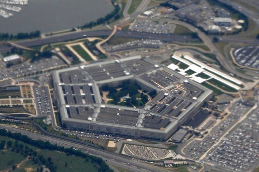 (AP Photo/Charles Dharapak, File). FILE - In this June 3, 2011, file photo, the Pentagon is seen from air from Air Force One. Defense Department investigators say the number of complaints filed against senior military and defense officials has increase...