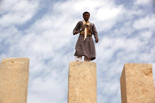 (AP Photo/Jon Gambrell). In this Saturday, Feb. 3, 2018 photo, a Yemeni militiaman stands atop a limestone column at the Awwam Temple, also known as the Mahram Bilqis, in Marib, Yemen. Experts fear the temple, as well as other historic and cultural won...