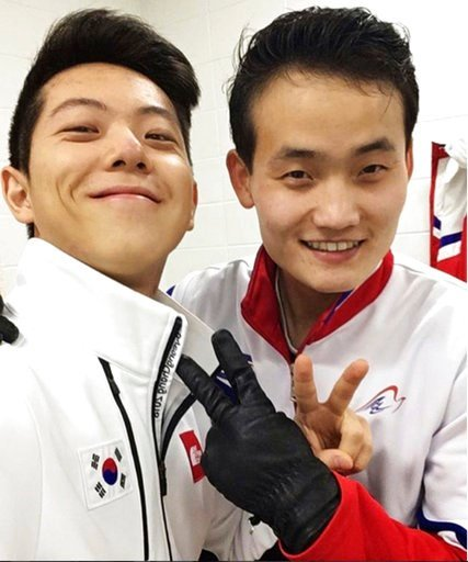 (Alex Kam via AP). This February 2018 selfie provided by South Korean figure skater Alex Kam and posted on Instagram, shows him, left, posing with North Korean skater Kim Ju Sik in Gangneung, South Korea, ahead of the 2018 Winter Olympics.