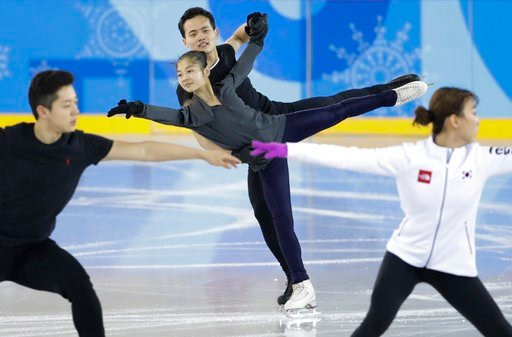(AP Photo/Felipe Dana). North Korea's Ryom Tae Ok and Kim Ju Sik, center, practice next to South Korea's Kim Kyu-eun, front right, and Alex Kam during a pairs figure skating training session prior to the 2018 Winter Olympics in Gangneung, South Korea, ...