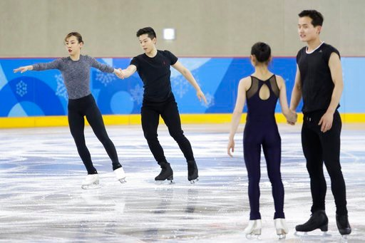 (AP Photo/Felipe Dana). South Korea's Kim Kyueun and Kam Alex Kang Chan, left, skate next to North Korea's Ryom Tae Ok and Kim Ju Sik during a Pairs Figure Skating training session prior to the 2018 Winter Olympics in Gangneung, South Korea, Monday, Fe...