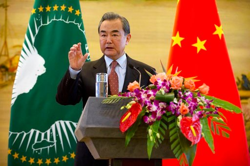 (AP Photo/Mark Schiefelbein). Chinese Foreign Minister Wang Yi speaks during a joint press conference with Chairman of the African Union Commission Moussa Faki Mahamat at the Ministry of Foreign Affairs in Beijing, Thursday, Feb. 8, 2018. Chinese and A...