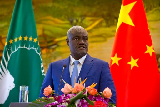 (AP Photo/Mark Schiefelbein). Chairman of the African Union Commission Moussa Faki Mahamat speaks during a joint press conference with Chinese Foreign Minister Wang Yi at the Ministry of Foreign Affairs in Beijing, Thursday, Feb. 8, 2018. Chinese and A...