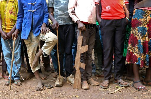 (AP Photo/Sam Mednick). Former child soldiers stand in line waiting to be registered with UNICEF to receive a release package, in Yambio, South Sudan Wednesday, Feb. 7, 2018. More than 300 child soldiers were released Wednesday by armed groups in South...