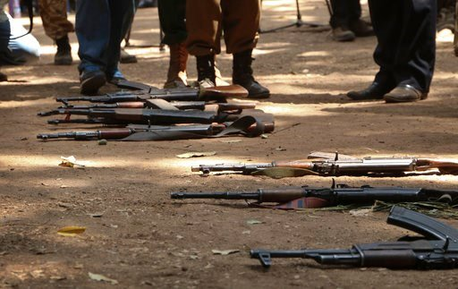 "(AP Photo/Sam Mednick). Guns that belonged to child soldiers lie on the ground at a release ceremony, where they laid down their weapons and traded in their uniforms to return to ""normal life"", in Yambio, South Sudan, Wednesday, Feb. 7, 2018. More than..."