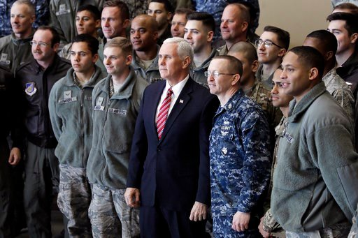 (Kiyoshi Ota/Pool Photo via AP). U.S. Vice President Mike Pence, center, pose for a photograph with U.S. military personnel at U.S. Yokota Air Base in Fussa, on the outskirts of Tokyo, Thursday, Feb. 8, 2018.