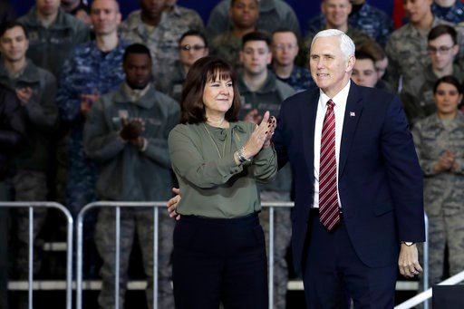 (Kiyoshi Ota/Pool Photo via AP). U.S. Vice President Mike Pence, right, and his wife Karen Pence applaud U.S. military personnel at U.S. Yokota Air Base, on the outskirts of Tokyo, Thursday, Feb. 8, 2018.