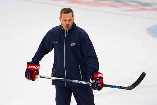 (AP Photo/Paul Sancya, File). FILE - In this March 30, 2017, file photo, United States coach Robb Stauber skates during practice in preparation for the IIHF Women's World Championship hockey tournament, in Plymouth, Mich. Stauber can't miss seeing the ...