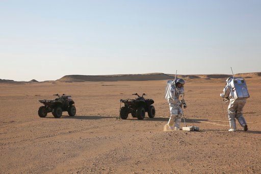 (AP Photo/Sam McNeil). In this Feb. 7, 2018, photo, two scientists test space suits and a geo-radar for use in a future Mars mission in the Dhofar desert of southern Oman. The desolate desert in southern Oman resembles Mars so much that more than 200 s...