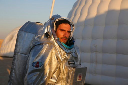 (AP Photo/Sam McNeil). This Feb. 7, 2018, photo shows João Lousada, a flight controller for the International Space Station, wearing an experimental space suit during a simulation of a future Mars mission in the Dhofar desert of southern Oman. The deso...