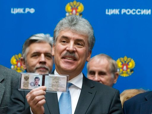 (AP Photo/Alexander Zemlianichenko). In this photo taken on Friday, Jan. 12, 2018, the Communist Party's candidate for the 2018 Russian presidential election Pavel Grudinin shows his candidate's ID to the media at the Russia Central Election commission...
