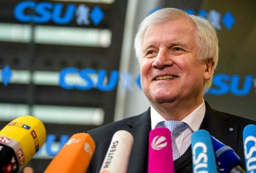 (Matthias Balk/dpa via AP). Bavarian Governor Horst Seehofer of the Christian Social Union, CSU, talks to media prior to the party's board meeting in Munich, southern Germany. The smallest of the parties in Germany's prospective new government has sign...