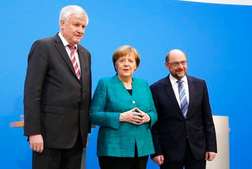(AP Photo/Ferdinand Ostrop). German Chancellor Angela Merkel, Chairwoman of the Christian Democratic Union, CDU, is flanked by Martin Schulz, chairman of the Social Democratic Party, SPD, and Bavarian Governor Horst Seehofer, chairman of the Christian ...