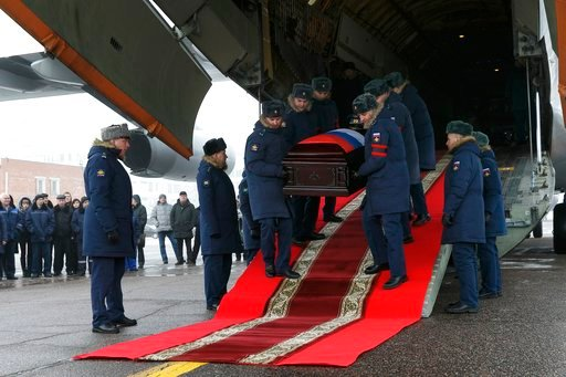(Vadim Savitsky/Pool Photo via AP). Russian officers carry out from a plane a coffin with the body of Russian Roman Filipov, the pilot of the Su-25 jet who ejected after Syrian insurgents shot down his plane traded fire with militants on the ground and...