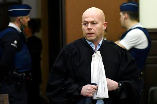 (Didier Lebrun, Pool Photo via AP). Belgian lawyer Sven Mary, center, attends the second day of the trial of Salah Abdeslam and Soufiane Ayari at the Brussels Justice Palace in Brussels on Thursday, Feb. 8, 2018.