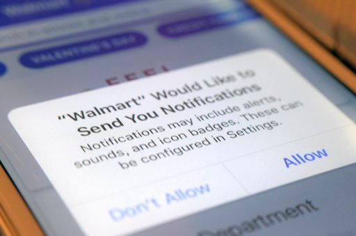 (AP Photo/Jenny Kane). This Wednesday, Feb. 7, 2018, photo shows a Walmart application prompt to enable notifications on an iPhone in New York. Data show that 9.6 times more users make a purchase when an app sends a promotional push notification compar...