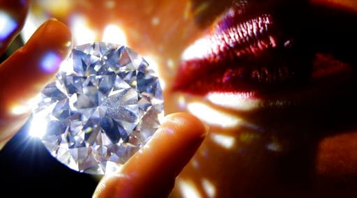 "(AP Photo/Alastair Grant). A 102.34, carat, D colour and flawless white diamond held by a model is displayed at Sotheby's auction house in London, Thursday, Feb. 8, 2018. The diamond is the world largest known round brilliant diamond to have achieved ""..."