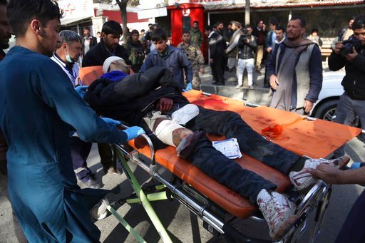 (AP Photo/Rahmat Gul, File). FILE - In this Saturday Jan. 27, 2018 file photo, an injured man arrives at a hospital following a suicide attack in Kabul, Afghanistan. A joint U.S. and Afghan air raid this week targeting the Islamic State group in Afghan...