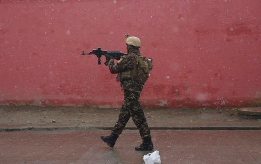 (AP Photo/Rahmat Gul, File). FILE - In this Monday, Jan. 29, 2018 file photo, a member of Afghan security personnel arrives at the site of an attack at a military academy in Kabul, Afghanistan. A joint U.S. and Afghan air raid targeting the Islamic Sta...