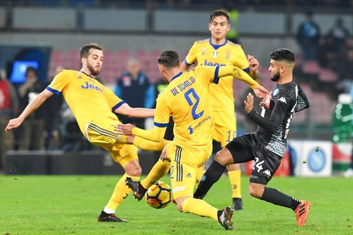 (Ciro Fusco/ANSA via AP, file). FILE - In this Dec. 1, 2017 file photo, Napoli's Lorenzo Insigne is caught in between Juventus' Miralem Pjanic, left, and Mattia De Sciglio during an Italian Serie A soccer match between Napoli and Juventus at the San Pa...