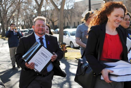 (AP Photo/James Nord, File). FILE - In this Feb. 23, 2016, file photo, Terri Bruce, left, walks toward the state Capitol in Pierre, S.D. Bruce said a new South Dakota bill to ban public school teaching on gender identity in elementary and middle school...