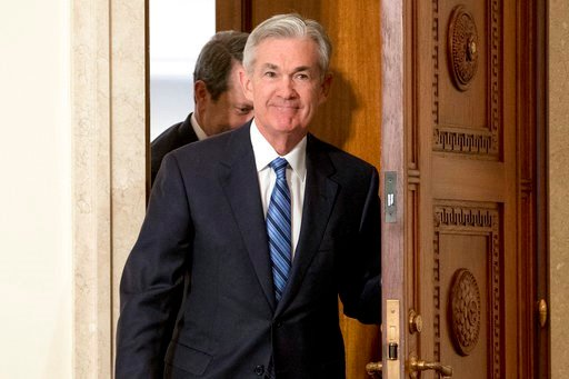 (AP Photo/Andrew Harnik, File). FILE- In this Monday, Feb. 5, 2018, file photo, Jerome Powell arrives to take the oath of office as Federal Reserve Board chair at the Federal Reserve in Washington. On Monday the Dow Jones industrial average endured its...