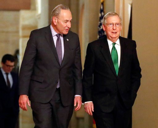 (AP Photo/Pablo Martinez Monsivais). Senate Majority Leader Mitch McConnell, R-Ky., and Senate Minority Leader Chuck Schumer, D-N.Y., left, walk to the chamber after collaborating on an agreement in the Senate on a two-year, almost $400 billion budget ...