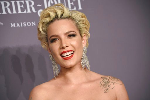 (Photo by Evan Agostini/Invision/AP). Halsey attends the Fashion Week amfAR Gala New York at Cipriani Wall Street on Wednesday, Feb. 7, 2018, in New York.