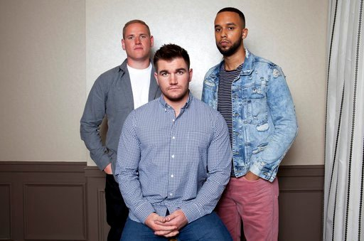 "(Photo by Rebecca Cabage/Invision/AP). In this Jan. 27, 2018 photo, Spencer Stone, from left, Alek Skarlatos, and Anthony Sadler, pose for a portrait to promote the film ""15:17 to Paris"" at the Four Seasons Hotel in Los Angeles. The trio, who famously ..."