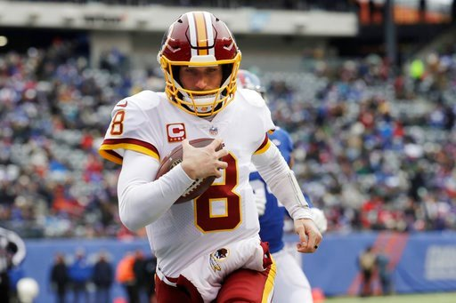 (AP Photo/Mark Lennihan, File). FILE - In this Dec. 31, 2017, file photo, Washington Redskins quarterback Kirk Cousins (8) rushes for a touchdown during the first half of an NFL football game against the New York Giants in East Rutherford, N.J. The qua...