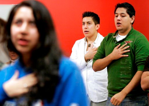 (AP Photo/Tony Gutierrez,File). FILE - In this Thursday, Feb. 7, 2008 file photo Manuel Rendon, center in white, along with fellow members, recite the Pledge of Allegiance at a meeting of the Collin County LULAC Young Adults Council #4780 at Collin Cou...
