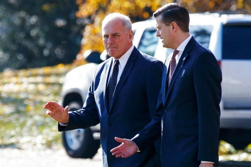 (AP Photo/Evan Vucci). In this Nov. 29, 2017 file photo, White House Chief of Staff John Kelly, left, walks with White House staff secretary Rob Porter to board Marine One on the South Lawn of the White House in Washington.