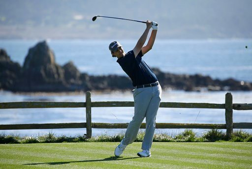 (AP Photo/Eric Risberg). Beau Hossler follows his drive from the 18th tee of the Pebble Beach Golf Links during the first round of the AT&T Pebble Beach National Pro-Am golf tournament Thursday, Feb. 8, 2018, in Pebble Beach, Calif.