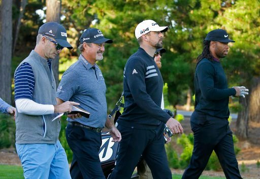 (AP Photo/Eric Risberg). From left, golfers Kevin Streelman, Jerry Kelly, and NFL football player Aaron Rodgers and Larry Fitzgerald make their way down the first fairway of the Spyglass Hill Golf Course during the first round of the AT&T Pebble Be...