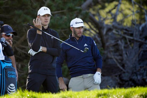 (AP Photo/Eric Risberg). Jordan Spieth, left, and Dustin Johnson, right, wait to hit from the third tee of the Spyglass Hill Golf Course during the first round of the AT&T Pebble Beach National Pro-Am golf tournament Thursday, Feb. 8, 2018, in Pebb...