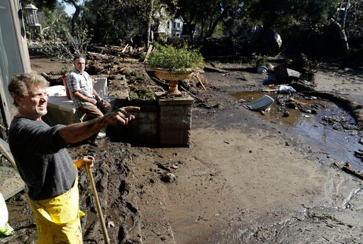(AP Photo/Marcio Jose Sanchez, file). FILE - In this Jan. 11, 2018, file photo, Bill Asher, left, and his friend Gil Loustalot survey storm damage to Asher's home in Montecito, Calif. Local emergency authorities preparing for future storms like the one...