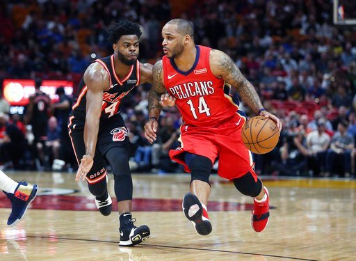 (AP Photo/Joel Auerbach, File). FILE - In this Dec. 23, 2017, file photo, New Orleans Pelicans guard Jameer Nelson (14) dribbles the ball against Miami Heat guard Derrick Walton Jr. (14) during the second half of an NBA basketball game in Miami. The De...