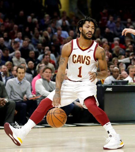 (AP Photo/Tony Dejak, File). FILE - In this Jan. 31, 2018, file photo, Cleveland Cavaliers' Derrick Rose (1) drives against the Miami Heat in the first half of an NBA basketball game, in Cleveland.  The Cavaliers sent guard Derrick Rose and forward Jae...