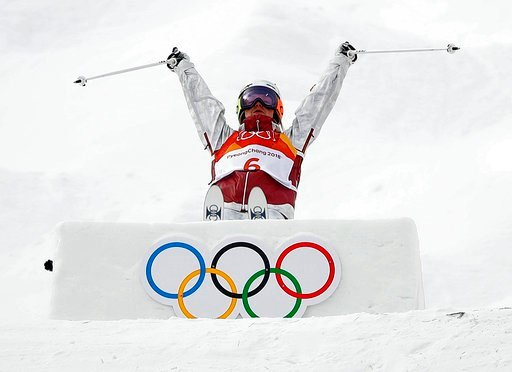 (AP Photo/Gregory Bull). Justine Dufour-Lapointe, of Canada, jumps during the women's moguls qualifying at the 2018 Winter Olympics in Pyeongchang, South Korea, Friday, Feb. 9, 2018.