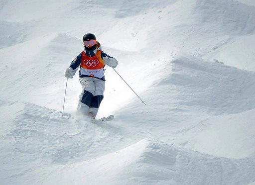 (AP Photo/Gregory Bull). KeatonMcCargo, of the United States, runs the course during the women's moguls qualifying at the 2018 Winter Olympics in Pyeongchang, South Korea, Friday, Feb. 9, 2018.