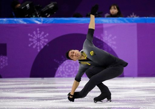 (AP Photo/David J. Phillip). France's Chafik Besseghier performs in the men's single short program team event at the 2018 Winter Olympics in Gangneung, South Korea, Friday, Feb. 9, 2018.