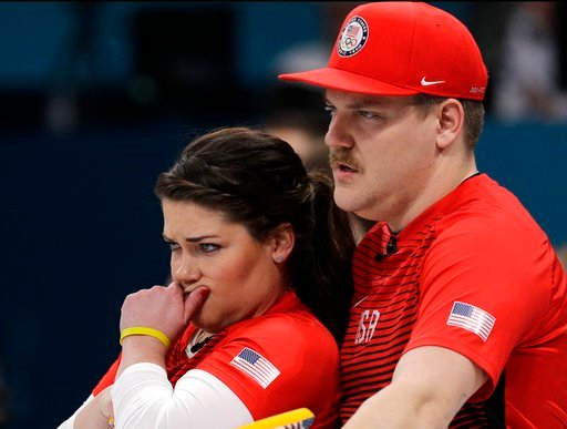 (AP Photo/Aaron Favila). United States' siblings Matt and Becca Hamilton huddle to discuss their strategy during their mixed doubles curling match against Switzerland at the 2018 Winter Olympics in Gangneung, South Korea, Friday, Feb. 9, 2018.